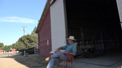 Cowboy rancher playing guitar Stock Footage