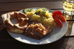 Stock Photo of leberkaese spam with roasted onions, pretzels and potato salad, schwaben, bav