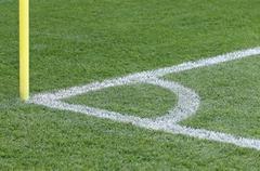 Close-up view of corner kick of the green soccer field Stock Photos