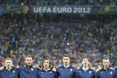 italy football team players sing the national anthems - stock photo