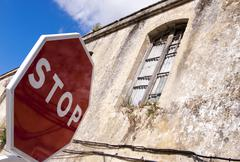 Stock Photo of stop sign in front of old ruins, andalucia, spain, europe