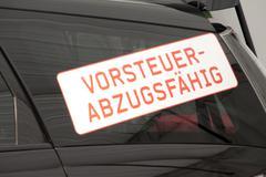 Stock Photo of car sticker, vorsteuerabzugsfaehig, german for vat deductible