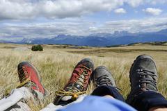 Feet of hikers resting, villanderer alm, alp pasture, sarntal alps at latzfon Stock Photos
