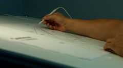 Man Draws Blue Prints Stock Footage