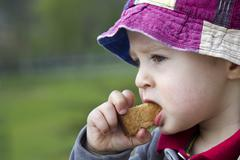 Young boy, 18 months, eating Stock Photos