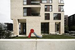 Stock Photo of drab playground in front of modern architecture, hafencity district, hamburg,