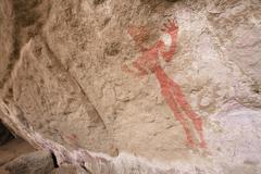 Prehistoric rock drawings in the tadrart valley, akakus mountains, libyan des Stock Photos