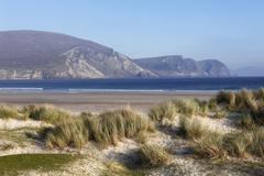 keel beach, cliffs and the dooega head, achill island, county mayo, connacht  - stock photo