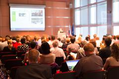 Audience at the conference hall. - stock photo