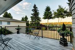 walkout deck overlooking backyard area - stock photo