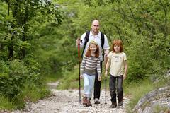 Father and children hiking on the albrecht duerer weg near laag, oltradige, b Stock Photos