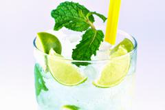 Mojito , lime pieces , leaves of mint with ice and rum Stock Photos
