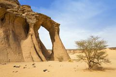 tin aregha sandstone arch in the akakus mountains, libyan desert, libya, saha - stock photo