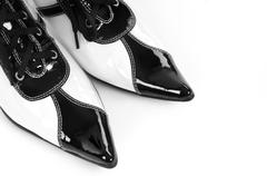 Toes of fancy lacquered black white shoes Stock Photos