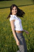 woman, 22 years, in a spring meadow - stock photo