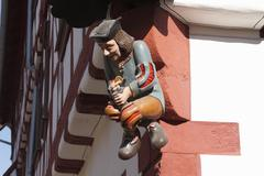 Stock Photo of carved figure on the corner of a house, karlstadt, mainfranken, lower francon