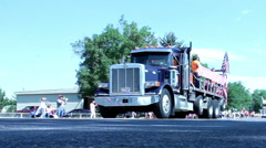 Low angle of large truck with train sounding whistle in local parade Stock Footage