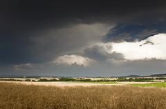 Thick storm clouds gathering over a farming area, bavaria, germany, europe Stock Photos