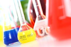 chemistry laboratory, various glass containers with liquids, chemicals, in va - stock photo