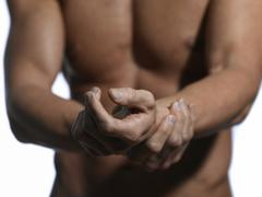 athletic man, upper body, hands - stock photo