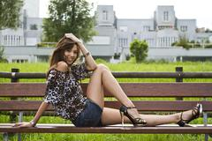 Young woman wearing hot pants, a leopard-print top and high heels, posing on  Stock Photos