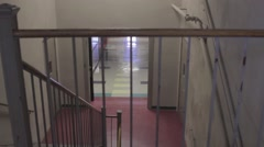 School stairs looking down into empty hall dolly Stock Footage