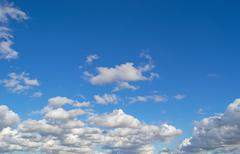 White, fluffy clouds Stock Photos