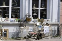 Goods displayed outside in front of a junk shop Stock Photos