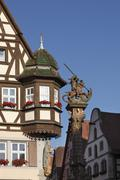Bay window on the marienapotheke pharmacy and equestrian monument of st. geor Stock Photos