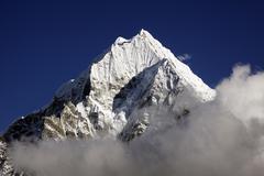 clouds in front of mt. thamserku, khumbu, sagarmatha national park, nepal, as - stock photo
