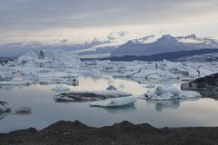 icebergs being reflected on the calm joekulsarlon glacial lake, iceland, euro - stock photo