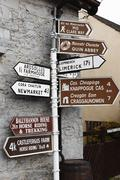 signpost in quin, county clare, ireland, europe - stock photo