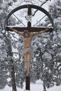 crucifix in winter, austria, europe - stock photo