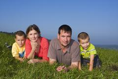 family, father 36 years, mother 30 years, children 6 and 4 years old - stock photo