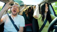 Two beautiful women and one handsome man dancing rock music like crazy in car Stock Footage