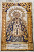 Stock Photo of tiled plaque of the blessed virgin mary, maria virgen de regla, on a sandston