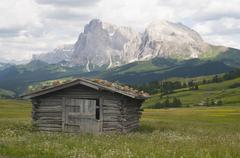 alpine hut in front of plattkofel and langkofel mountains, seiser alm, south  - stock photo