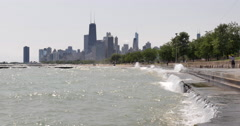 Chicago northside skyline with Lake Michigan waves in foreground. Stock Footage