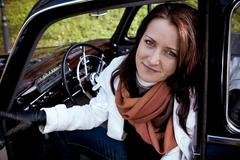 Young woman in a vintage mb vehicle Stock Photos