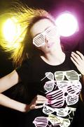 woman, 24, posing with a cool pair of glasses and a t-shirt - stock photo