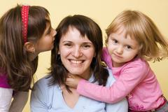 Mother, 36, with little girls, 3 and 7 years Stock Photos