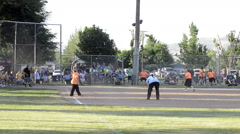 Spectators watch small town annual coed softball tournament Stock Footage