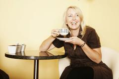 woman, 49, in a cafe - stock photo