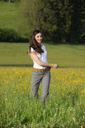 Woman, 22 years, in a spring meadow Stock Photos