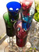 Stylish, colourful tinted champagne glasses on a silver platter Stock Photos