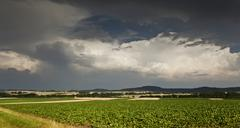 thick storm clouds gathering over a farming area, bavaria, germany, europe - stock photo