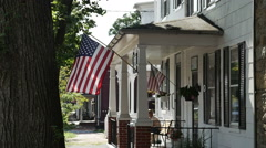 Stock Video Footage of 2077 American Flag on House in Slow Motion