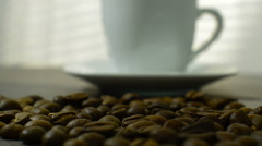 Coffee beans fall on a wooden table Stock Footage