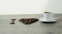 Stirring coffee, a cup of coffee costs on a wooden table Stock Footage