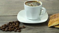 Stock Video Footage of white cup of coffee costs on a wooden table